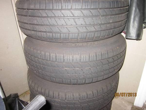 4 AS NEW TIRES WITH RIMS - $335